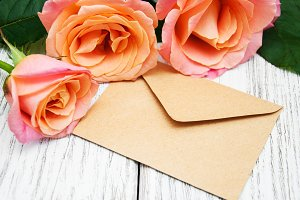 Pink roses and envelope