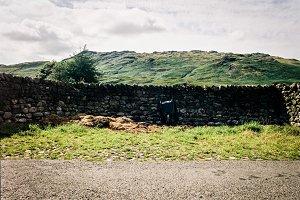 wheelbarrow at the wall