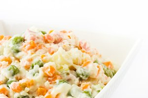 Russian salad on white background
