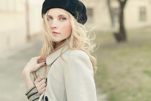 blond girl in a beret and coat