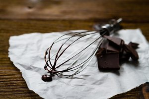 Chocolate with whisk on baking paper