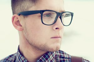 Portrait of stylish guy with glasses