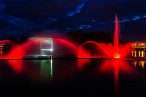 Night magic show of fountains on the central waterfront Roshen