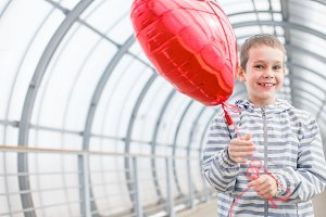 red balloon heart in hands