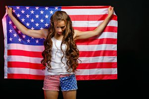 Girl holding US flag