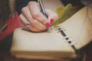 Women writing in retro notebook