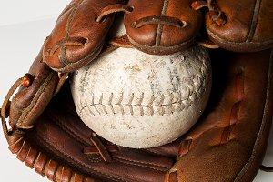 Old worn baseball glove and ball