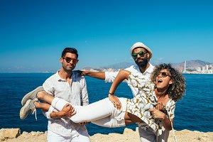 friends in sunglasses posing beach