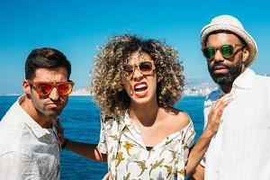 Stylish people in sunglasses posing