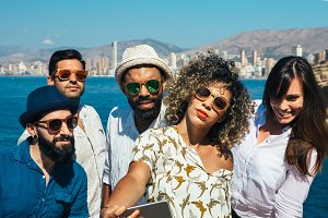friends in sunglasses makes selfie