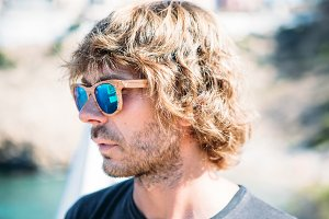 Long haired man in wooden sunglasses