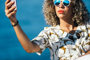 Afro american woman makes selfie