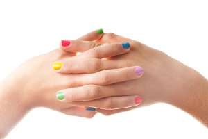 Hand with colored nails