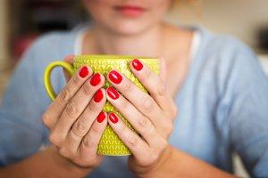 Woman holding a mug.