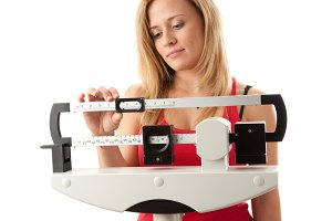 Young woman adjusting scale