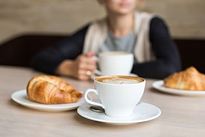 Croissant with cup of coffee.