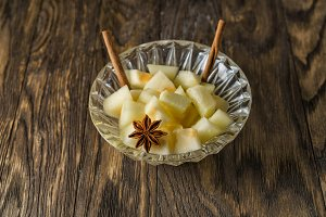 Melon dessert with cinnamon sticks.