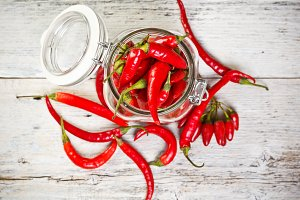 Glass jar with red chili peppers