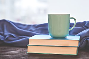Cup on books