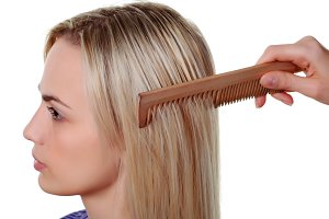 long hair and wood comb