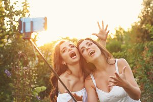Two sisters make fun selfie