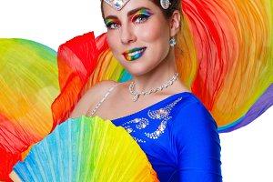 Girl dancing with rainbow fan.