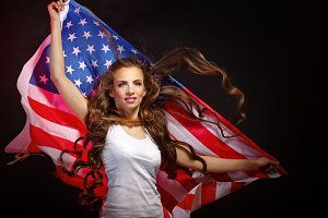 Girl holding US flag waving
