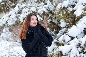 Lovely girl in a fur coat