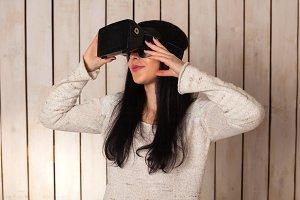 Woman in virtual reality helmet.