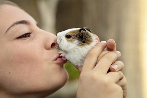 Happy girl with your Guinea pig