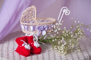 baby stroller, booties and bouquet