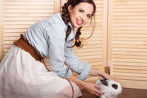 Nice girl with a rabbit