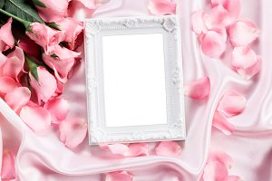 Empty photo frame with rose