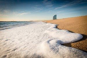 Wave foam on the beach