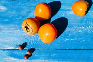 ripe persimmon on a blue background
