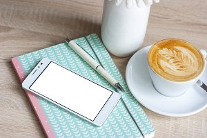 Smartphone at the table with coffee
