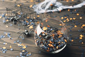 Halloween party confetti on dark background