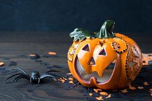 Halloween pumpkin and spider on dark background