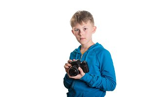 Boy with camera isolated on white