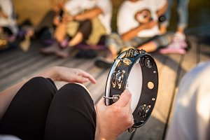 Person playing  tambourine
