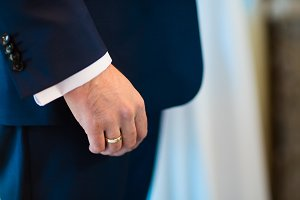 Man's hand with wedding ring