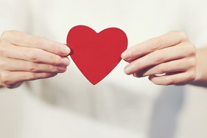 Hands holding Heart Love symbol