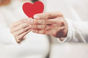 Couple in love holding Heart shape