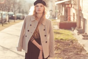 beautiful girl in a coat and beret