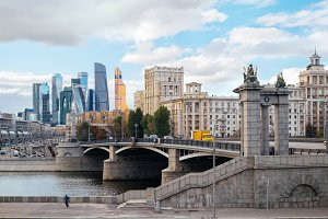 Landscape of Moscow architecture with massive Borodinsky bridge, some old classical buildings and modern city skyscrapers view on a background, Russia