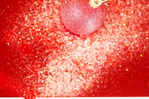 Holiday background with red bauble