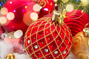 red christmas ball under evergreen tree