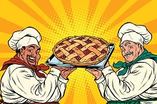 multi-ethnic chefs with berry pie