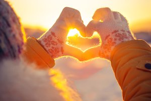 Woman hands in winter gloves Heart