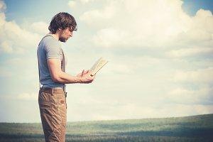Young Man Traveler reading